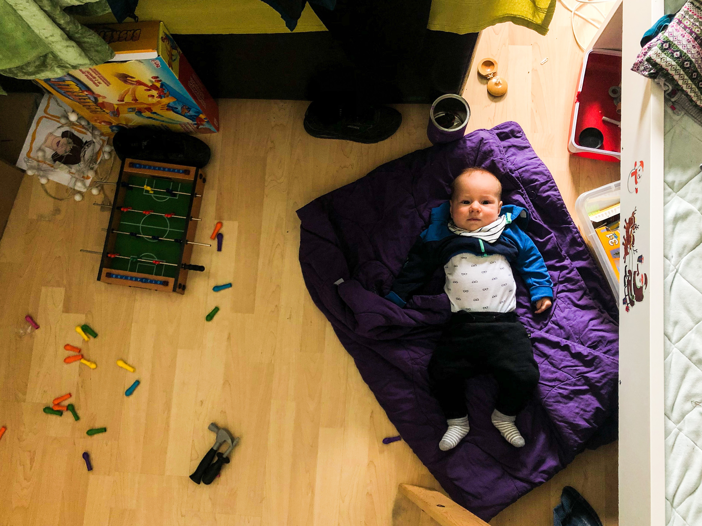 5 monthes old baby lying on the floor in mess looking straight up