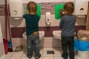 two boys washing their hands in the kindergarten toilette-Day-in-the-kindergarten-MaMagare-Zagreb-family-photographer 7727
