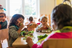 kid enjoying green salad with closed eyes