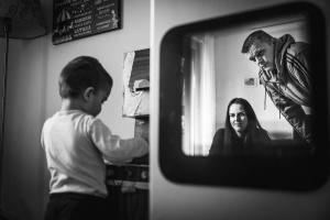 black and white family portrait parents in reflection of a mirror