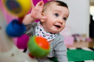 colorful girl reaching little hand