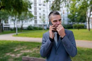groom biting his nails and making a phone call