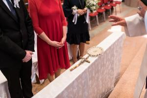 a priest blessing rings during wedding ceremony