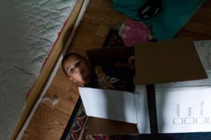 boy in paper box