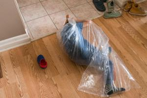 boy in plastic bag