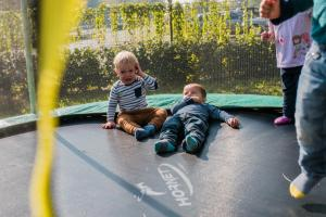 two boys in trampoline one crying other looking what happened